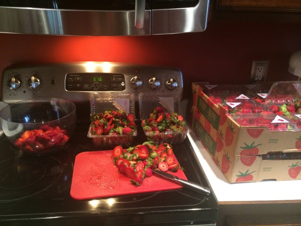 Prepping strawberries for freezing may be a hassle but it is worth it!