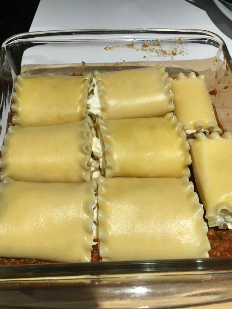 Place Lasagna Roll ups in a 8x8 baking dish and cover with sauce #CampbellSavings