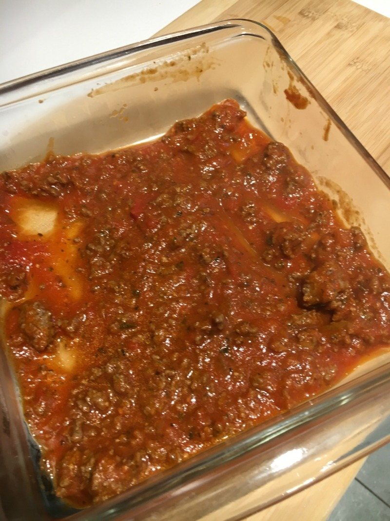 Spread Prego Italian Sauce with ground beef in the bottom of a 8X8 pan #CampbellSavings