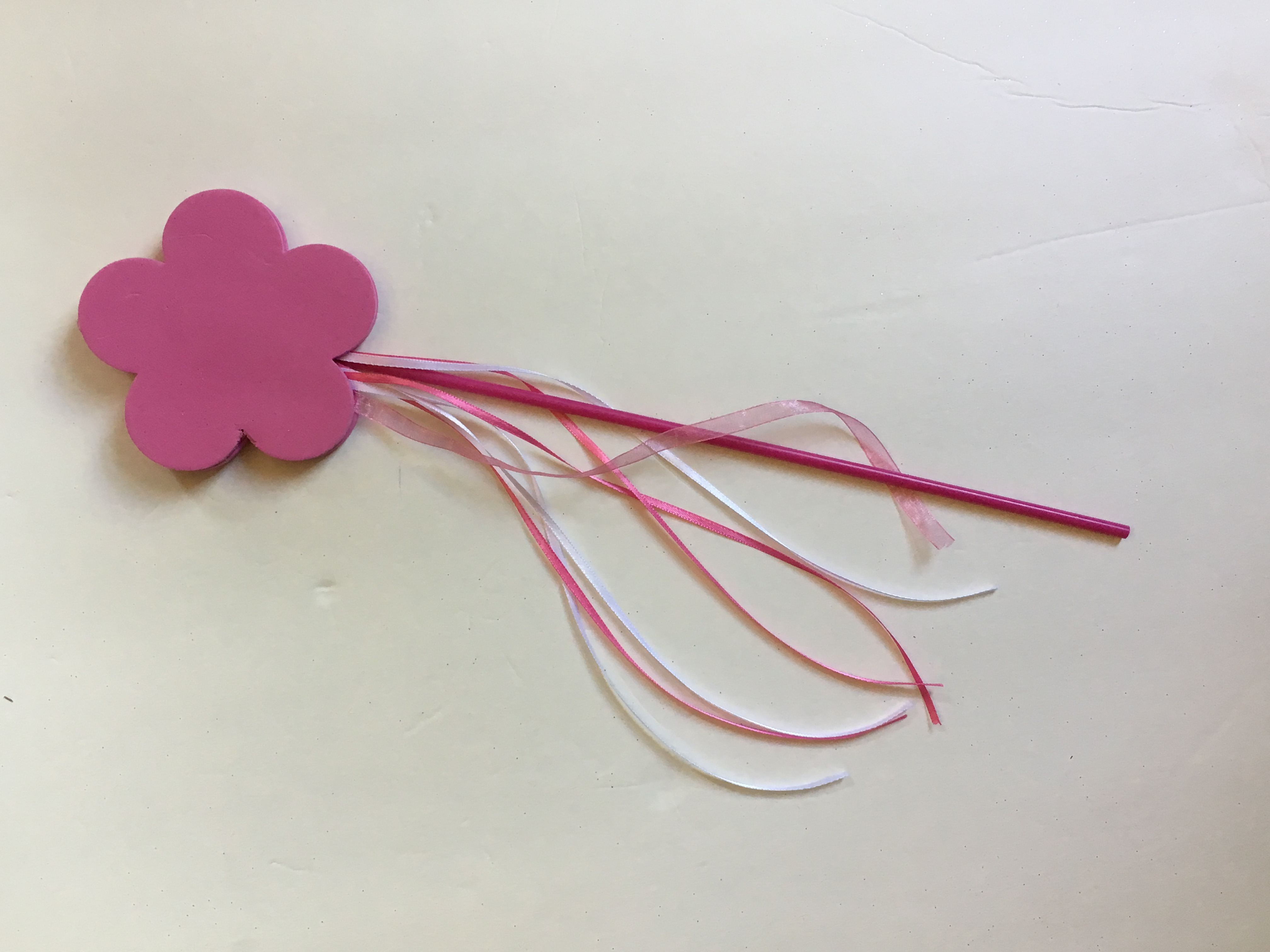 The finished wand is the perfect accessory for the DIY No Sew Tulle Tutu.