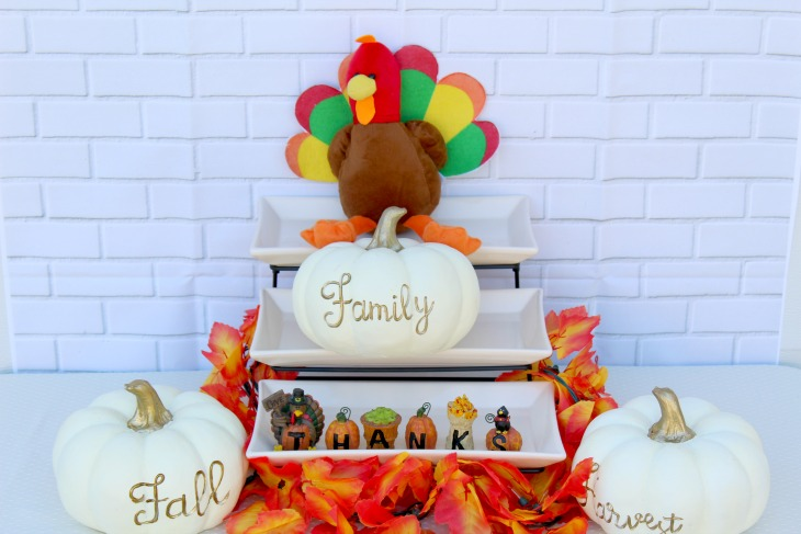 This festive Thanksgiving Centerpiece adds some whimsy and charm to the table--how cute are those white pumpkins?