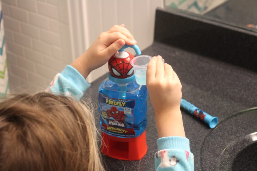 The Firefly Pump Mouthwash is easy to use for little hands and comes with its own little cup--cuts down on messes! #GoodCleanFun