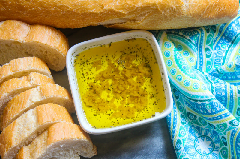 This Easy Recipe for Garlic Infused Olive Oil is so yummy and can be used as dipping sauce with crusty bread, over your favorite pasta or to make homemade garlic bread.